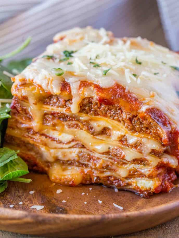 Image result for Beef lasagna made with ragu sauce with a mixed side salad