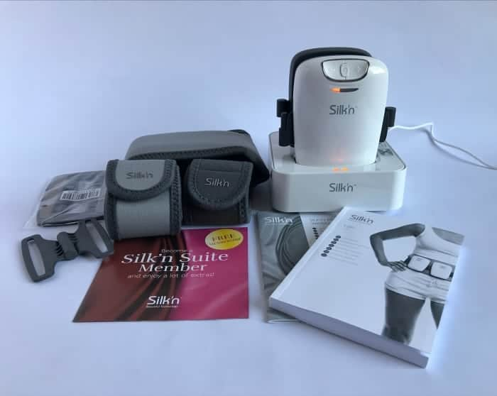 The contents of the Silk'n Lipo fat reduction belts: EMS electrode pads, 3 different sized Velcro body belts and laser pad connectors, 2 diode laser pads in their charging cradle, warranty and user guide booklet, support membership card.